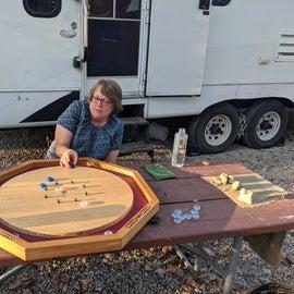 Kathy playing crokinole