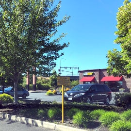 Parking lot entrance on left, Subway on right