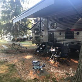 Picnic table and fire pit provided by campground
