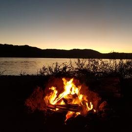 Campfire at sunset.